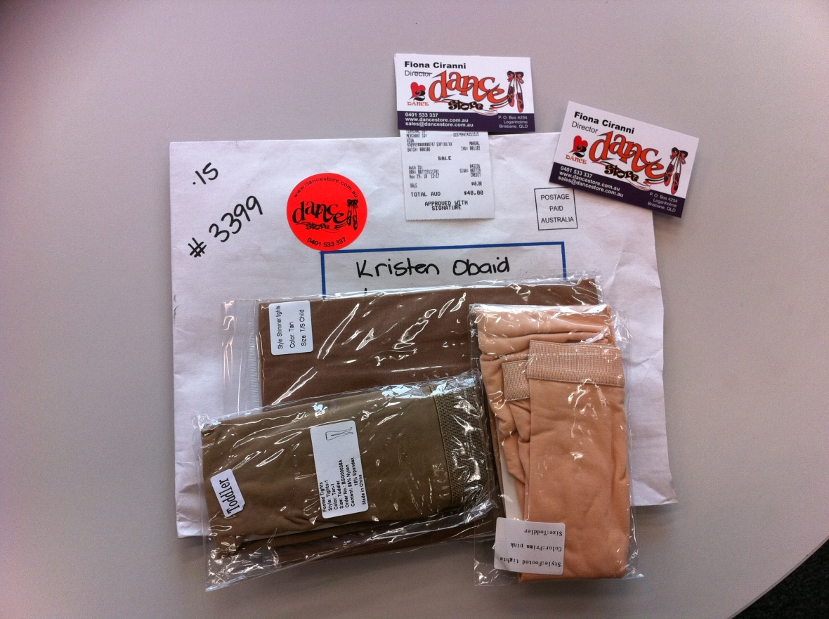 Mail pack from www.dancestore.com.au with stockings, business cards & receipt.