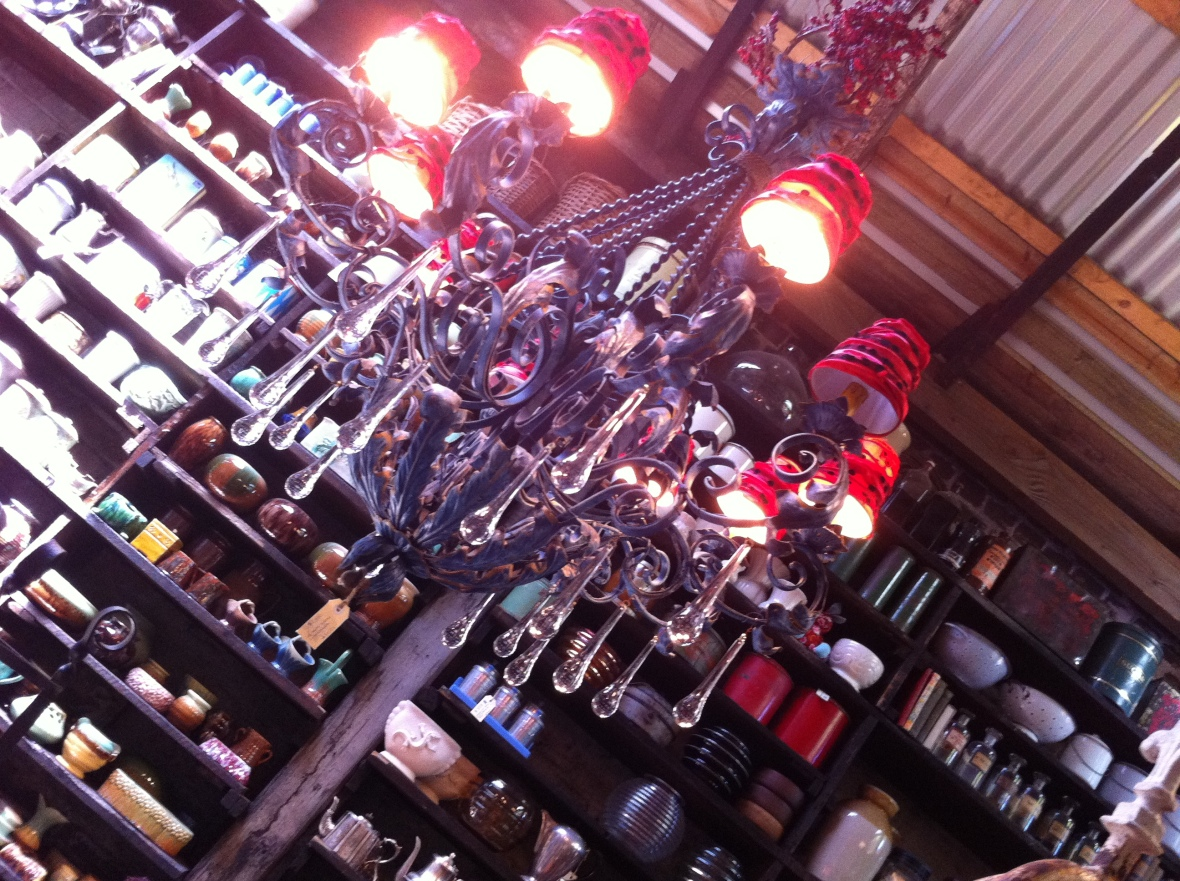 Chandelier and bottles in Aladdin's cave - Seasonal Concepts - 122 Redfern Street Redfern