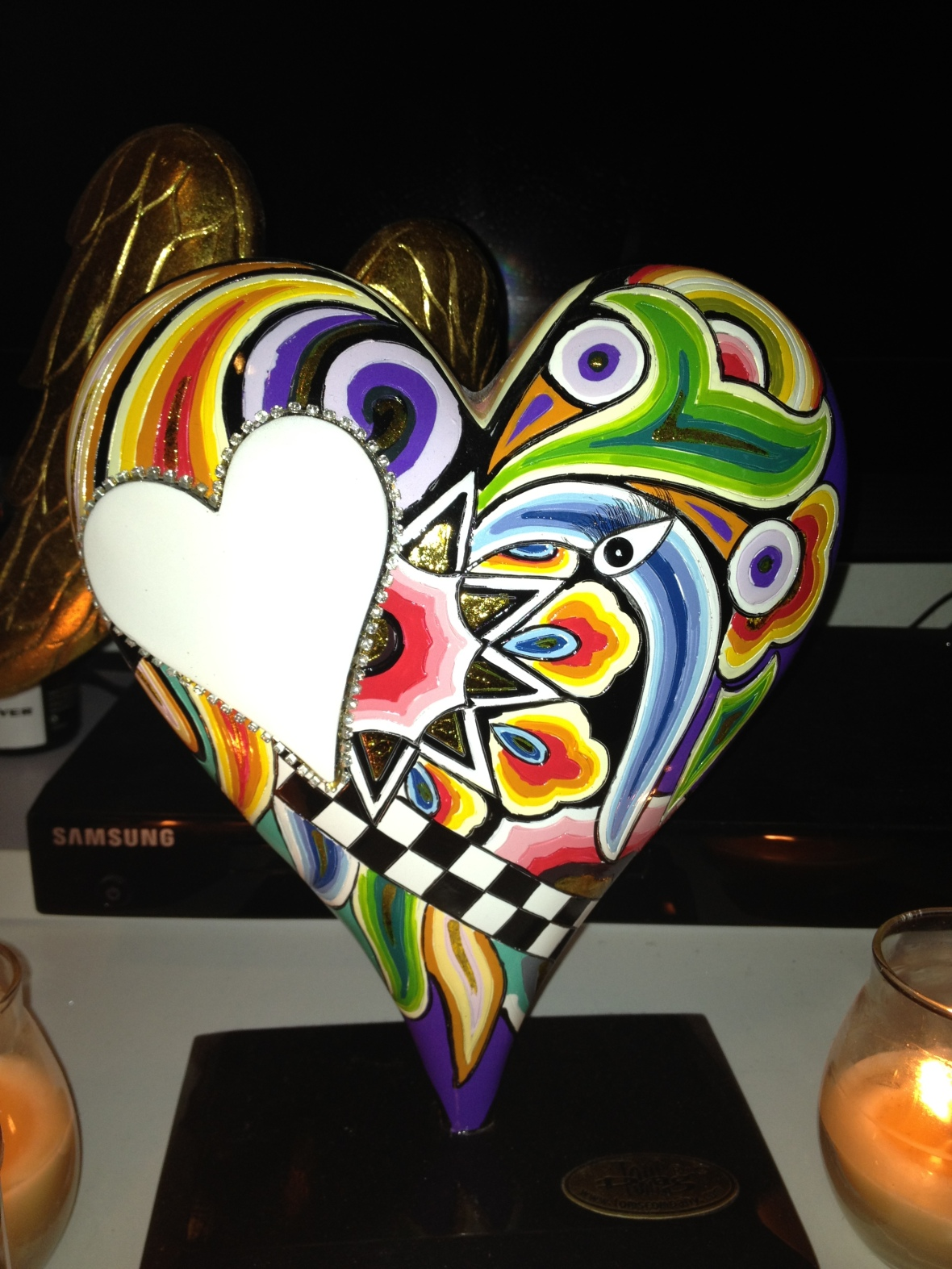 Beautiful South American style sacred heart colourfully painted with wings