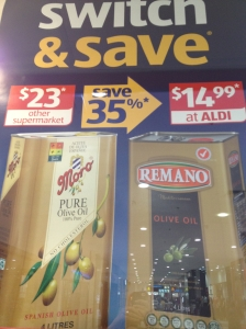 Catalogue - ALDI comparative price olive oil wall poster instore POS
